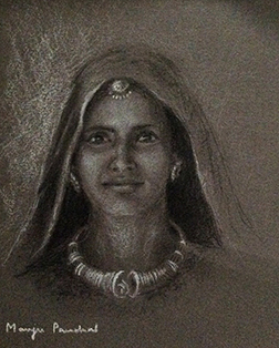 A portrait sketching of a woman from Kutch using charcoal pencil and white pastel pencil on grey hand made paper. By Manju Panchal