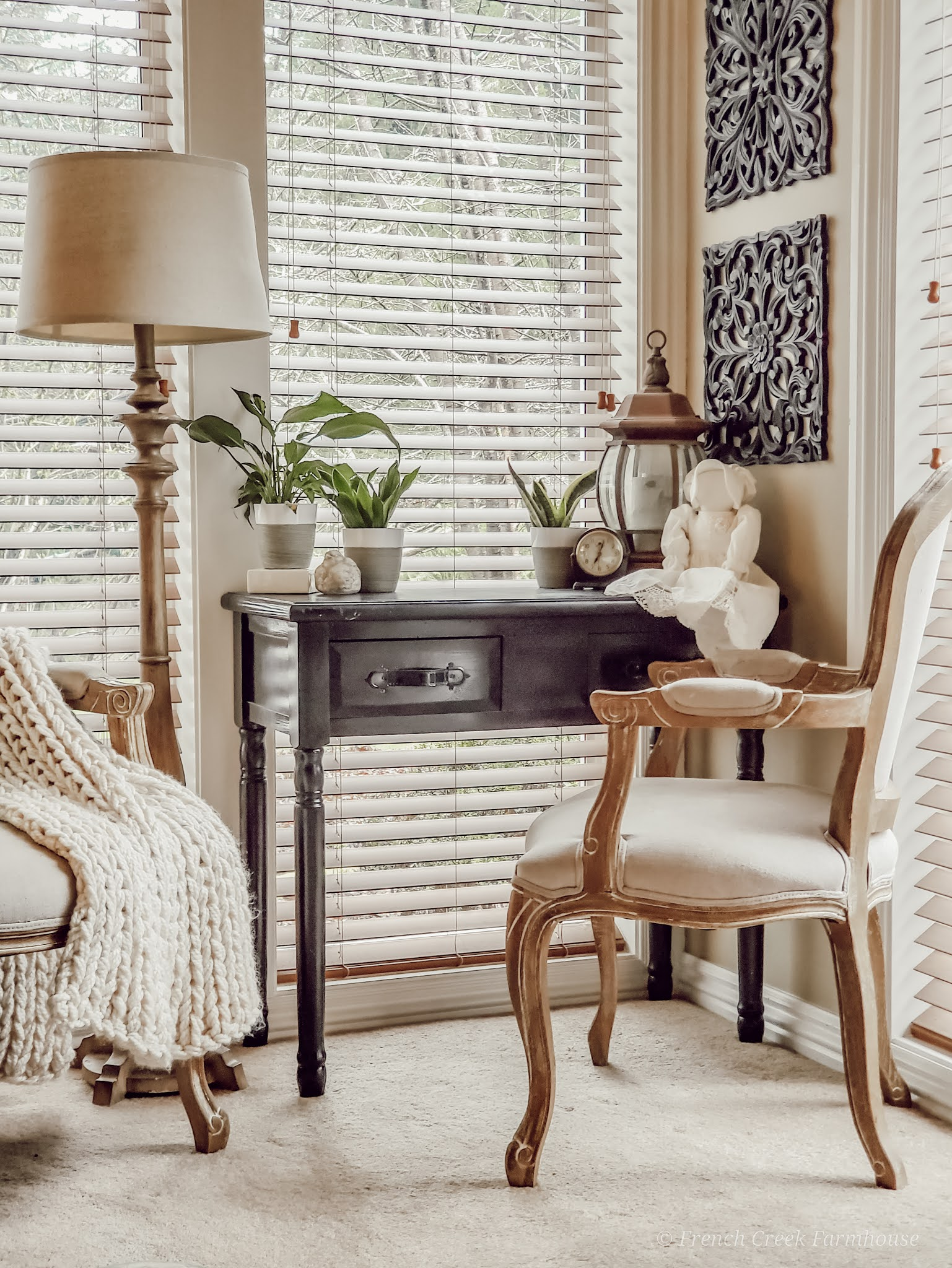 French country writing desk in front of window