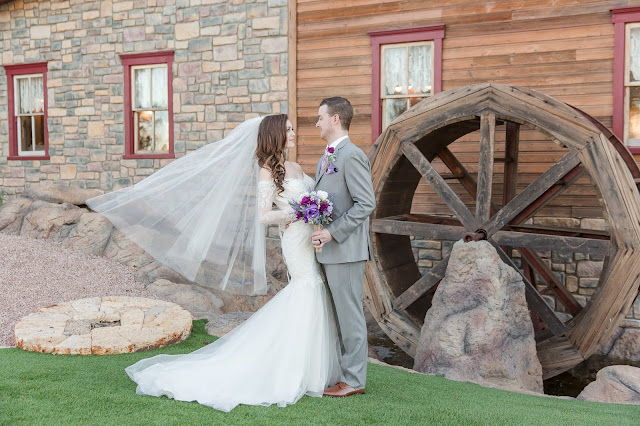 Shenandoah Mill Wedding Portraits of Bride and Groom by waterwheel by Micah Carling Photography