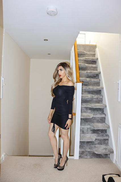 The Femme Luxe Black Ribbed Bardot Ruched Bodycon Mini Dress in model Vada.