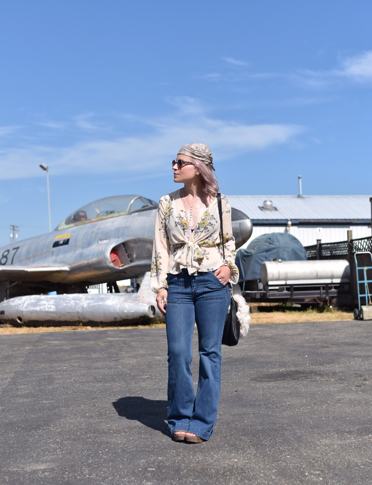 Flight plan:  styling a tie-front floral blouse with flare jeans and a bandana head scarf
