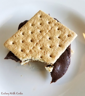 graham cracker sandwich with fudge frosting in between
