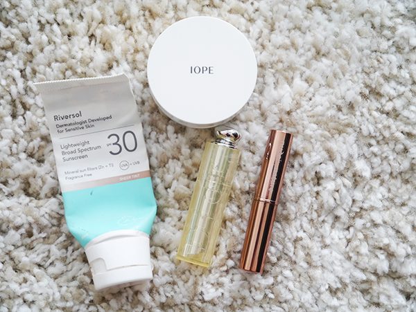 Empty skincare and makeup products from Riversol, Iope, Dior, Nude by Nature
