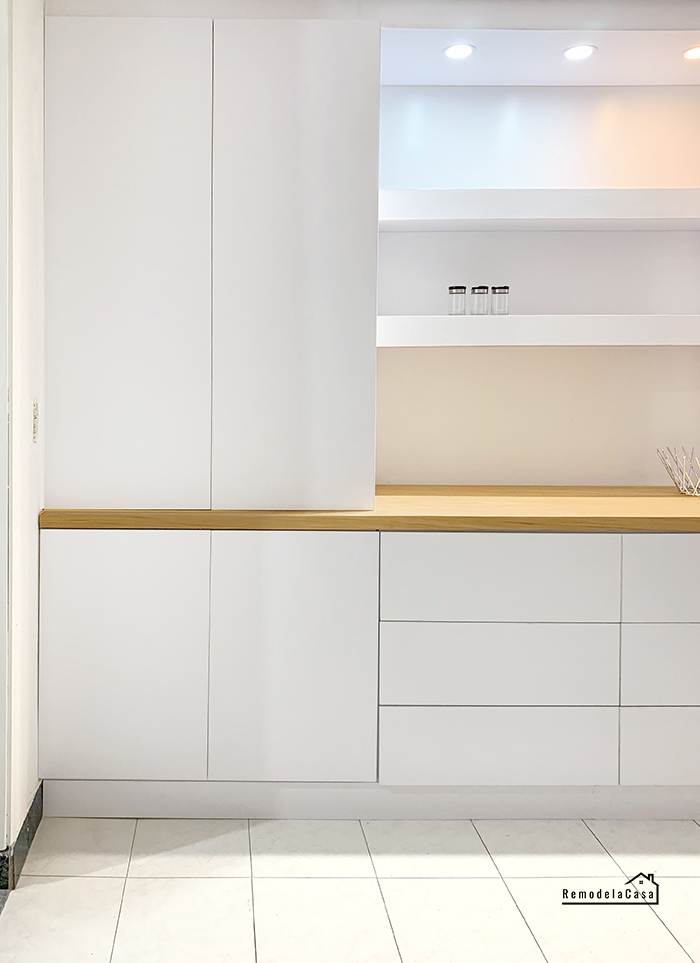 White built-in unit in dining room with floating shelves