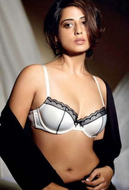 mahie-gill-wearing-white-bra-showing-cleavage