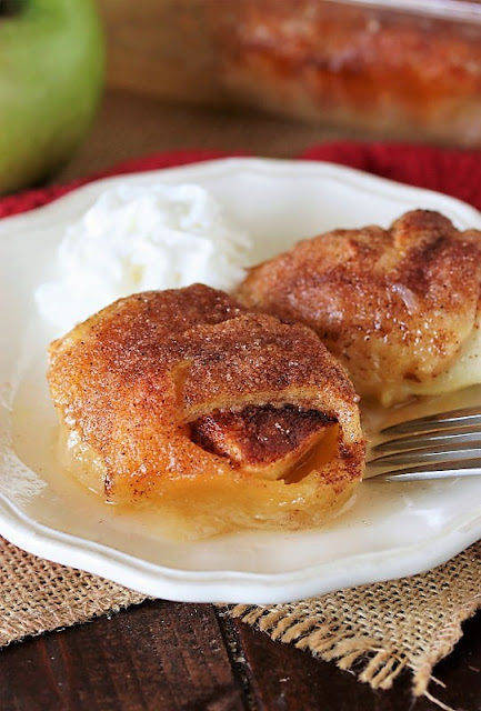 Serving of Crescent Roll Apple Dumplings on Dessert Plate Image