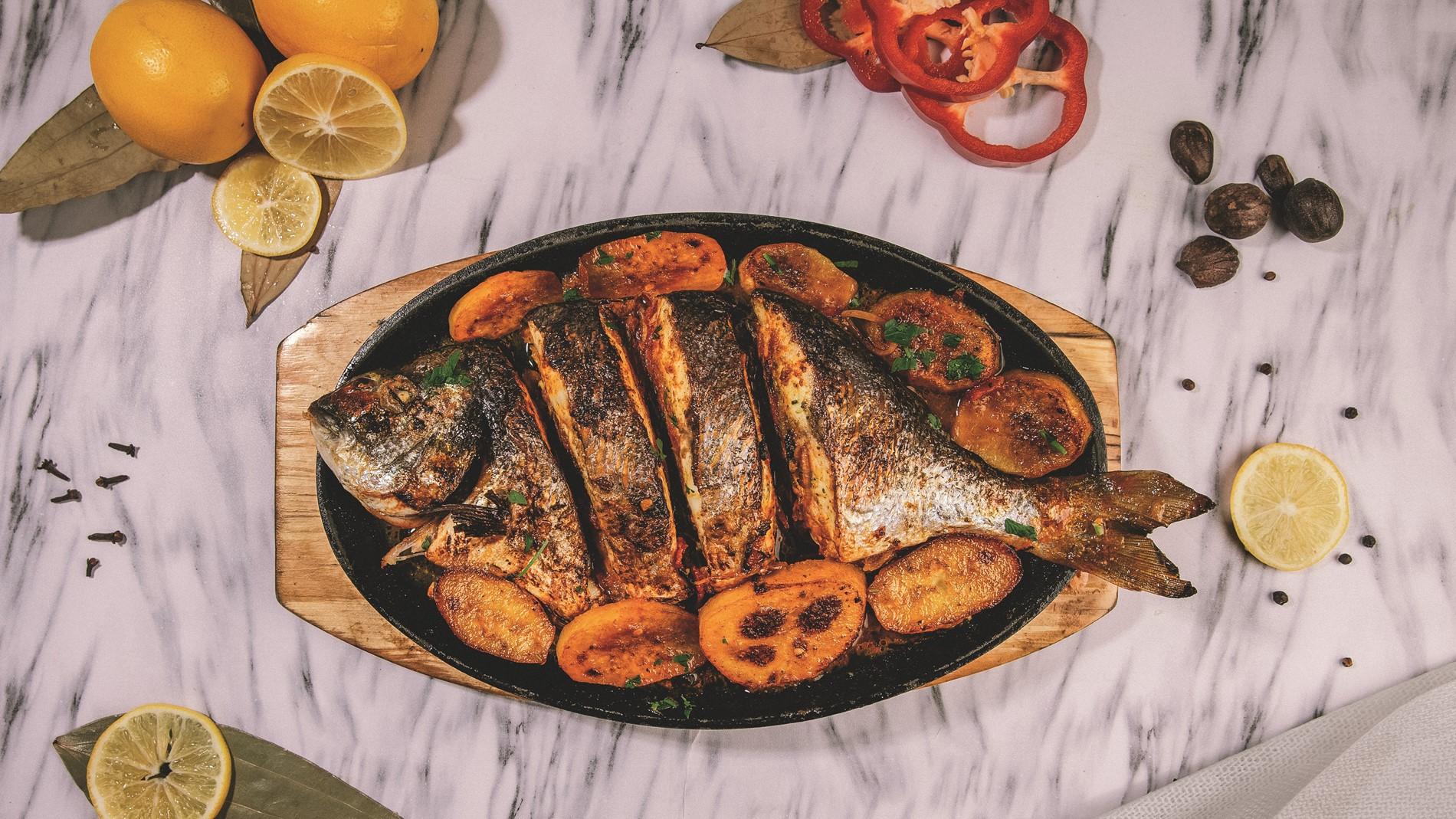 سمكة سي بريم بالزيت والليمون