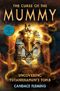 Book cover featuring the golden mask that was with the king in his tomb. There are swirls of light and dusty swirling air around it. The mask is golden with blue accents. There are two snakes up at the forehead.