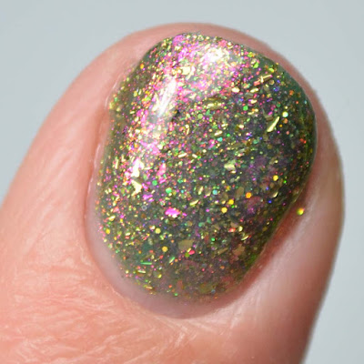 green nail polish with color shifting flakies close up swatch