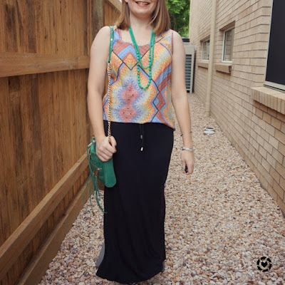 awayfromtheblue Instagram | mixed print tank with green statement necklace matching rebecca minkoff mini 5 zip bag black maxi skirt mum style