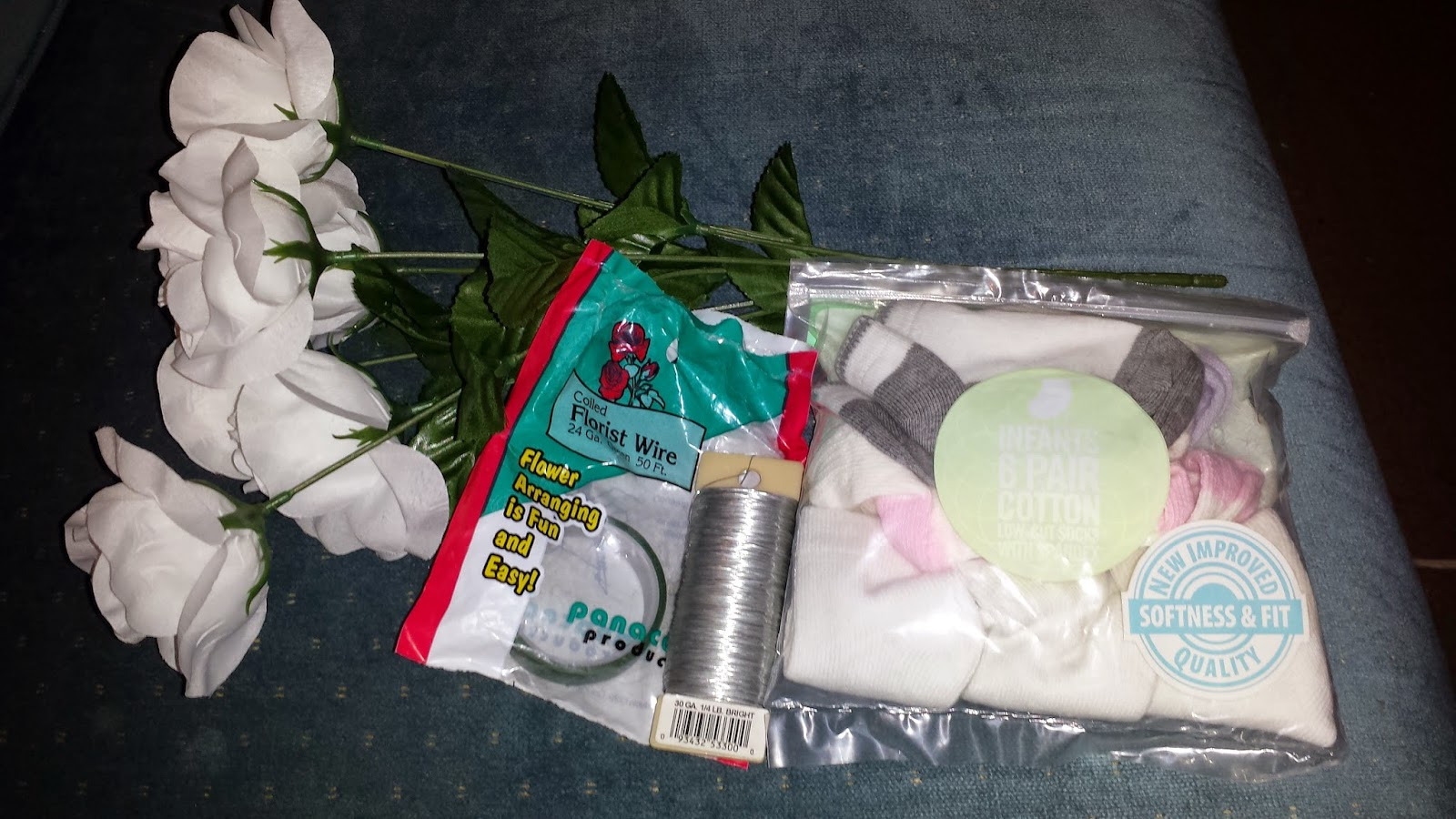 Supplies: silk flowers, floral wire and tape, baby socks