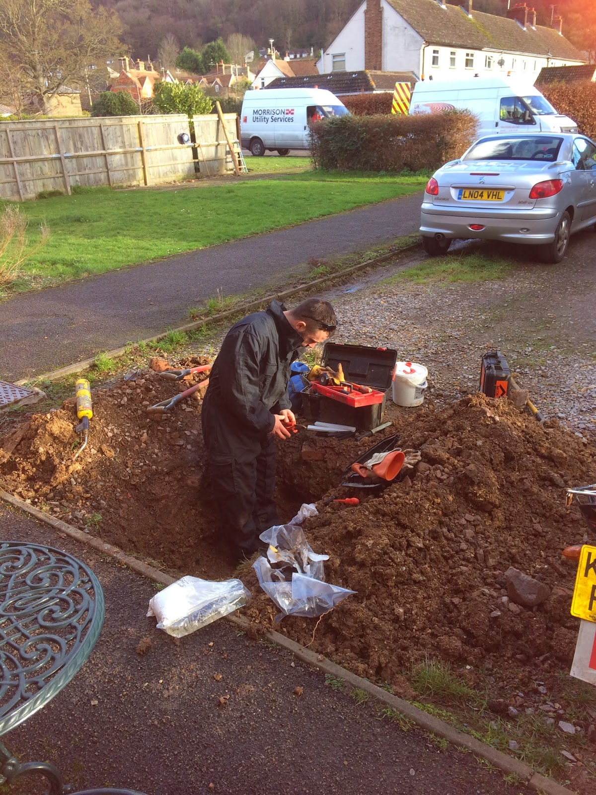 workman in hole