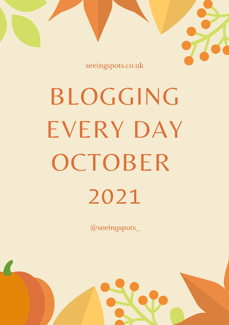 Poster, with autumnal foliage boarder, with Blogging every day in October as the text across the centre