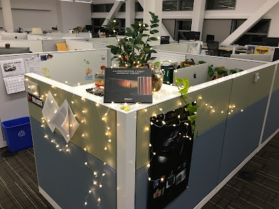 My desk at work last December, complete with pizza-shaped lights