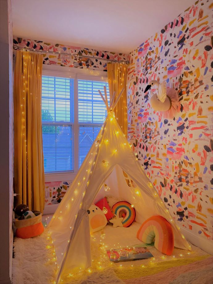 Use a teepee outfitted with twinkly lights to create a cozy spot for toddler to read- designaddictmom