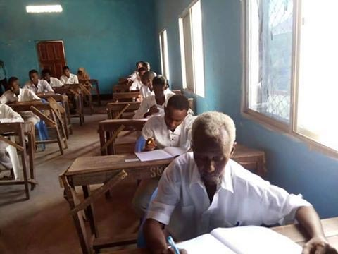 See 60-year old man writing WAEC in secondary school