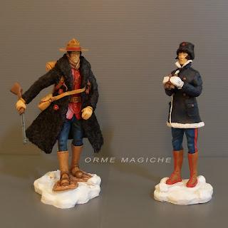 action figure da fumetti statuette  ispirate da personaggi disegni e acquarelli neve orme magiche