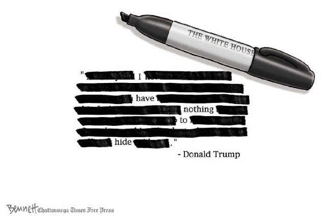 Image of sharpie labeled White House next to a document with multiple words marked out so that all that remains is