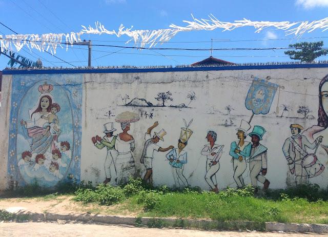Painel recriando manifestação folclórica trazida pelos escravos: Congo