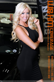 W&HM blond cover model Ashley Twomey in short black dress at Autocon 2016 car show