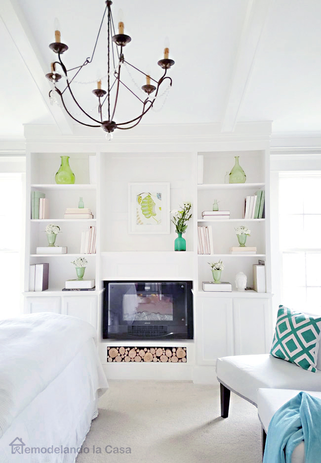 Green pops of color in the bedroom bookcase