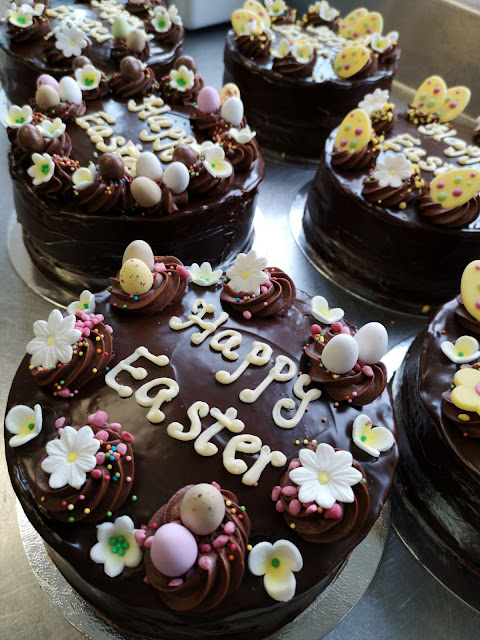 several chocolate Easter cakes saying Happy Easter