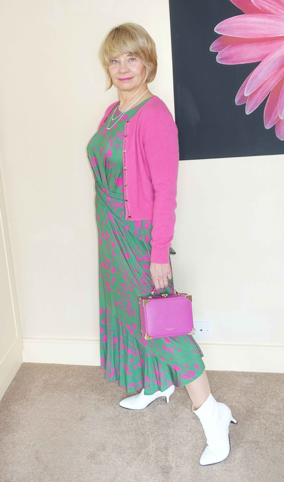 Adding a cashmere cardigan to a pink and green asymmetric midi dress makes it perfect for transitional dressing