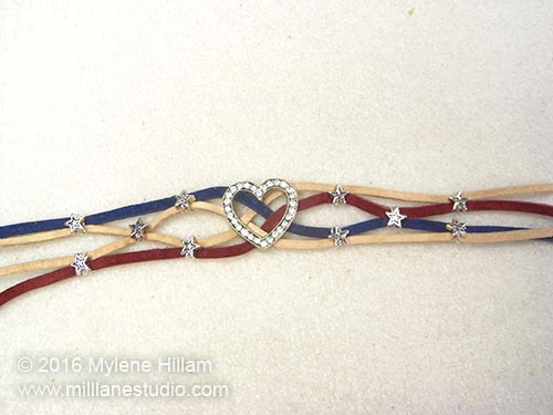 The leather lace stripes has been strung with star beads.