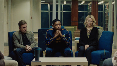 Luce 2019 movie still where Tim Roth, Kelvin Harrison Jr., and Naomi Watts sit together during a meeting with Kelvin's teacher and principal at school