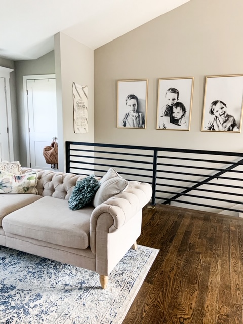 Large black and white photos hanging over stairs
