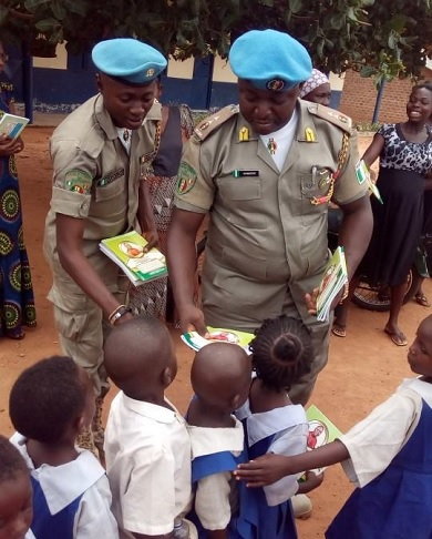 Cross River Commandant of the Peace Corps of Nigeria,  Patriot Okweche Dominic Distributing The Books to The Pupils At St. Dominic Primary School Ibiaragidi-Iye in Ibiaragid,  Bekwerra local government area of