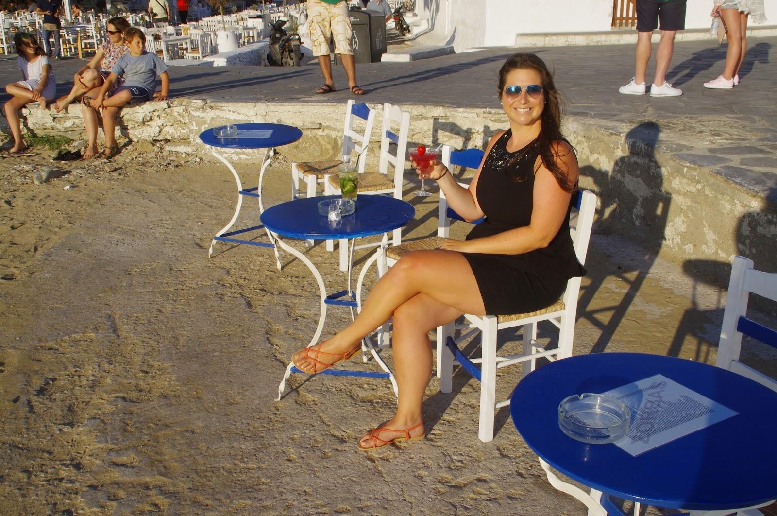 Girl having cocktails at Little Venice Mykonos