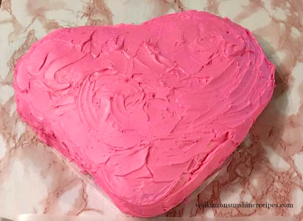 Pink frosting on top of my heart shaped cake for Valentine's Day from Walking on Sunshine.