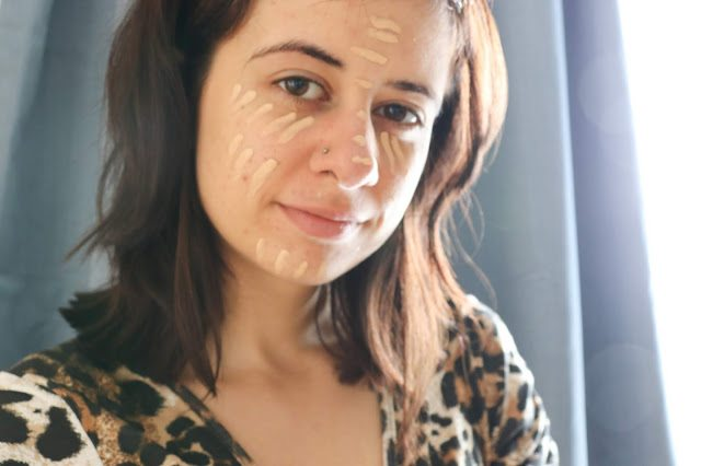 Laura with concealer all over her face