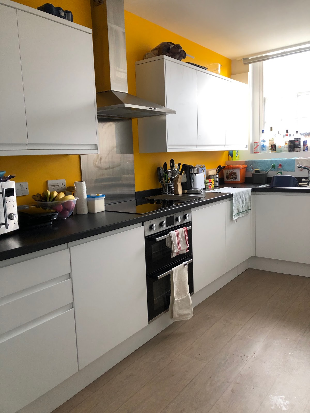 More cupboards, sink, kitchen surfaces