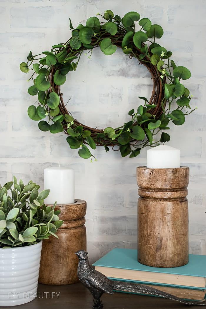 greenery wreath hanging above nightstand
