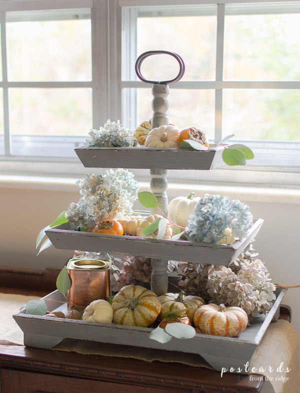 3 tier wooden tray with dried hydrangeas, pumpkins, and persimmons
