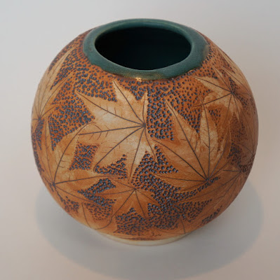 Handmade pottery vase with maple leaf imprints by Lily L.