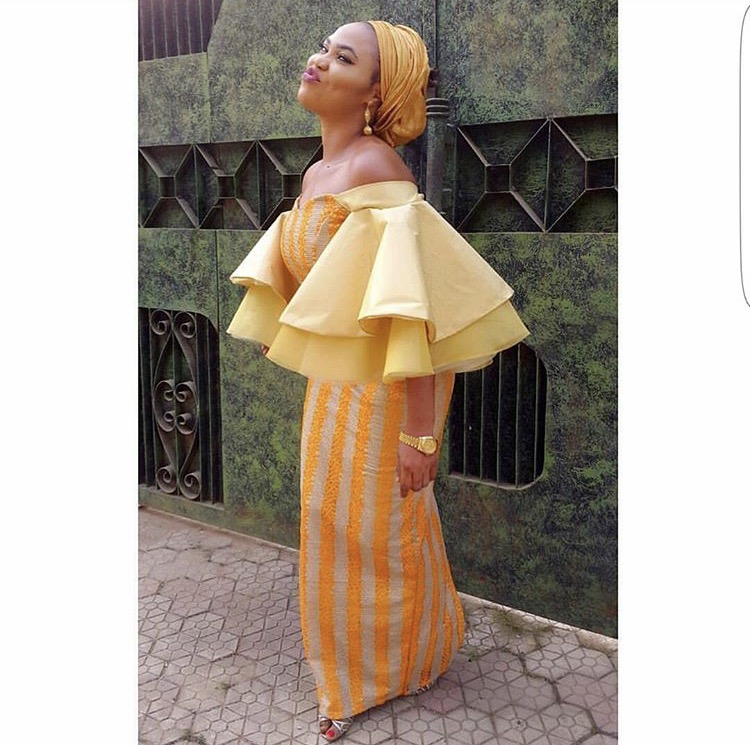 girl wearing a yellow bell sleeve ankara dress