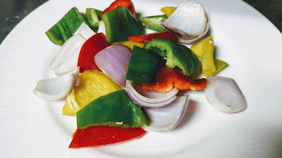 Cubes of bell peppers and onions for paneer Tikka