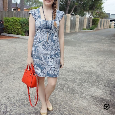 awayfromblue Instagram | blue paisley print sheath dress in office with red micro avery cross body bag