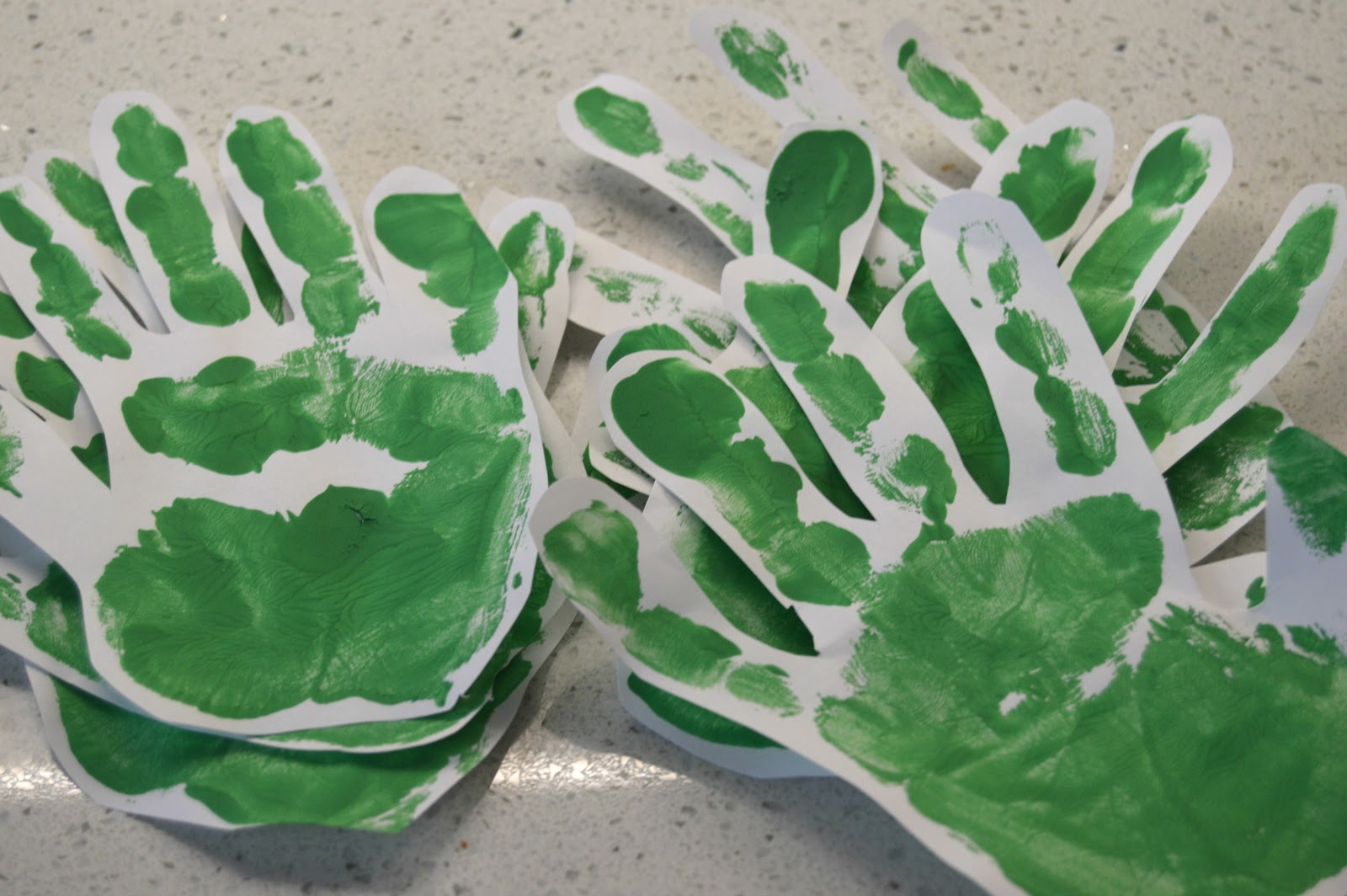 green handprints on paper