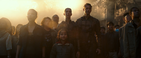 Madison Russell, Josh Valentine, Bernie Hayes, Ilene Andrews, Jia and Nathan Lind (Alexander Skarsgård) watch as Godzilla departs from Hong Kong in GODZILLA VS. KONG.