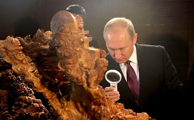 Vladimir Putin watching an exhibition of Chinese arts and crafts.