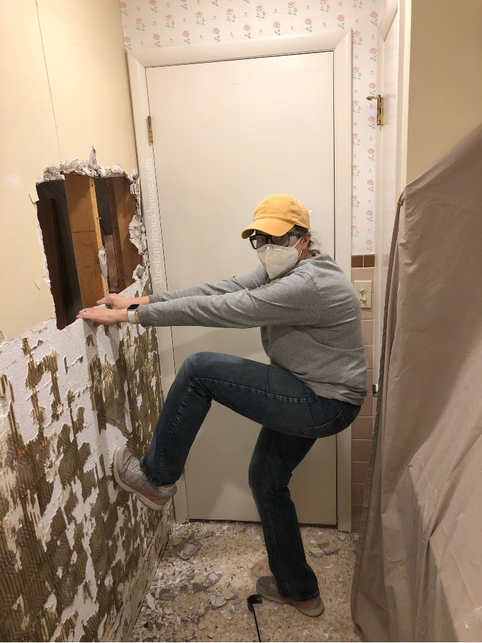 Tiles are off, take down the wall