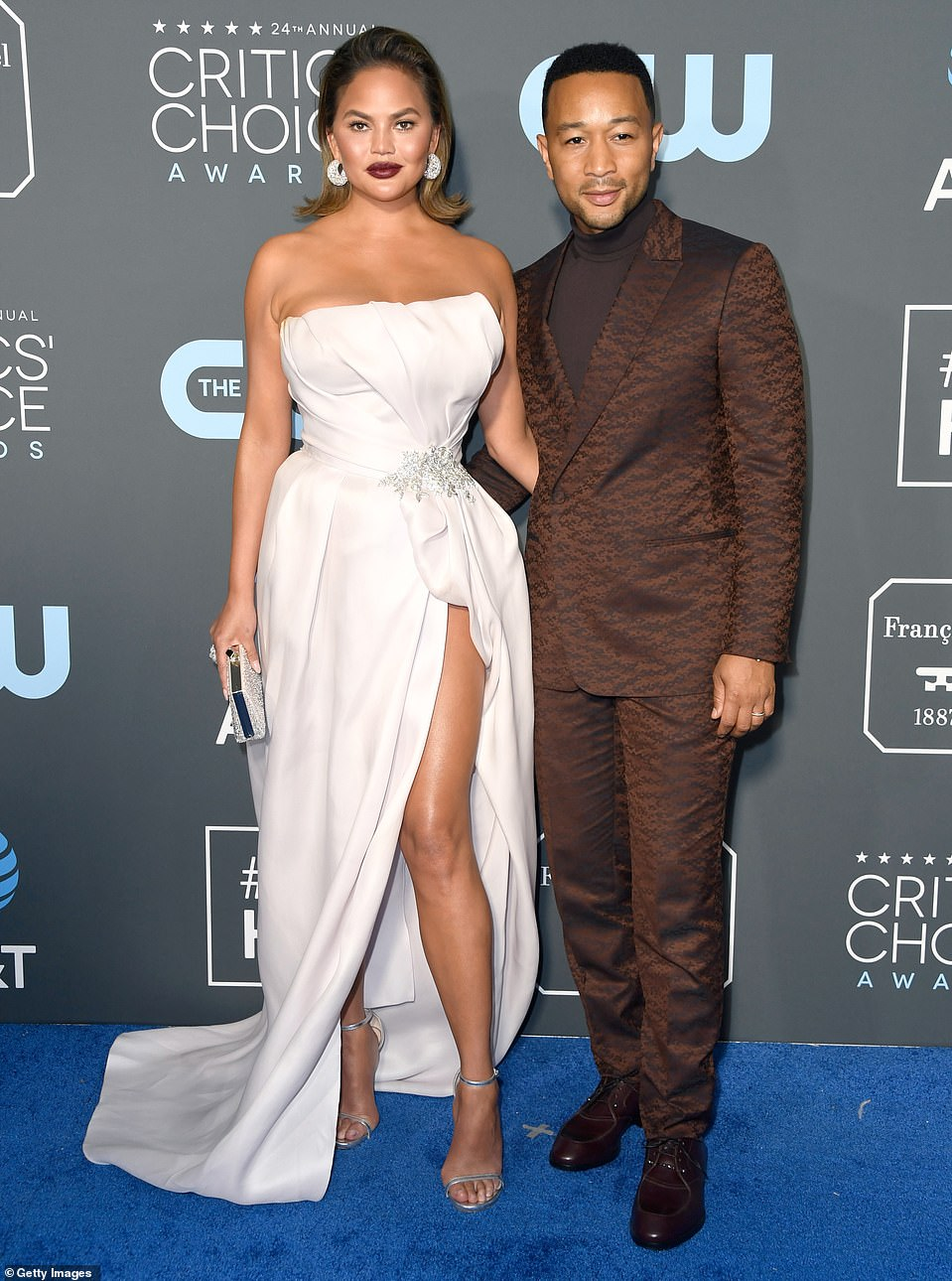 Chrissy Teigen wears strapless satin to the 2019 Critics' Choice Award