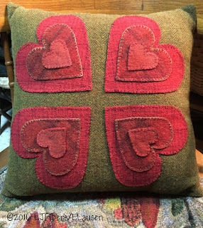 https://www.etsy.com/listing/293166777/hand-stitched-12-hearts-wool-pillow-free