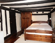 Bedroom with rafters