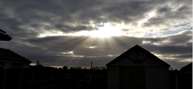 The sun peeking through the clouds.