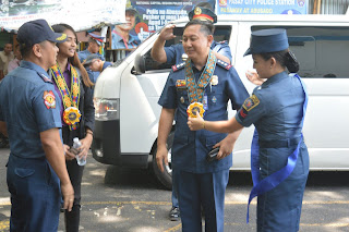 Philippine National Police Officers receiving a Philippine-flag inspired rosette leis in Pasay City, Metro Manila, Philippines